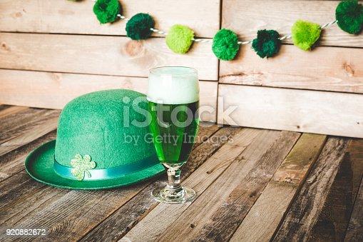 istock Glass of green beer with Irish festive hat 920882672