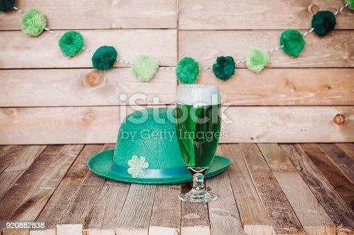 istock Glass of green beer with Irish festive hat 920882838