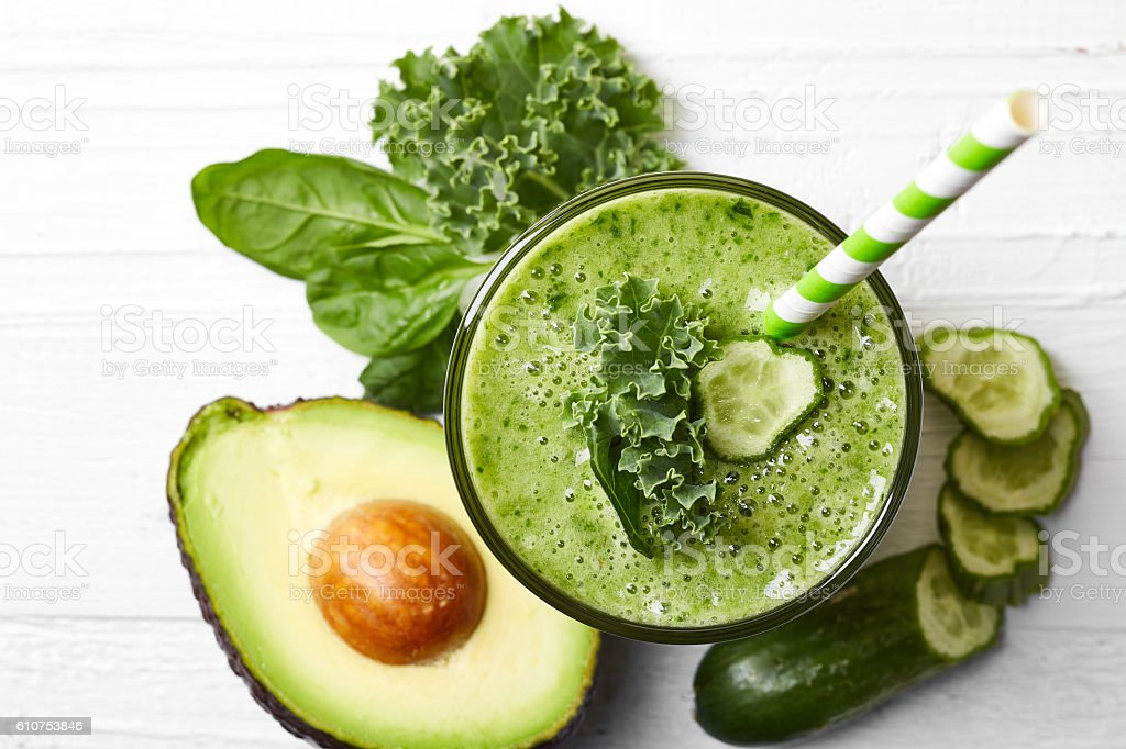 Glass of green vegetable smoothie stock photo