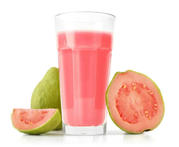 Glass of Guava Smoothie Glass of Guava Smoothie with fresh Guava fruit isolated on white background guava stock pictures, royalty-free photos & images