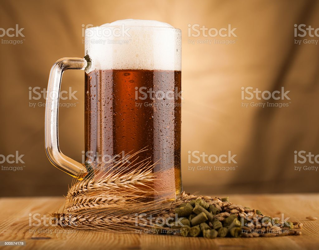 glass  of home made  beer on table stock photo