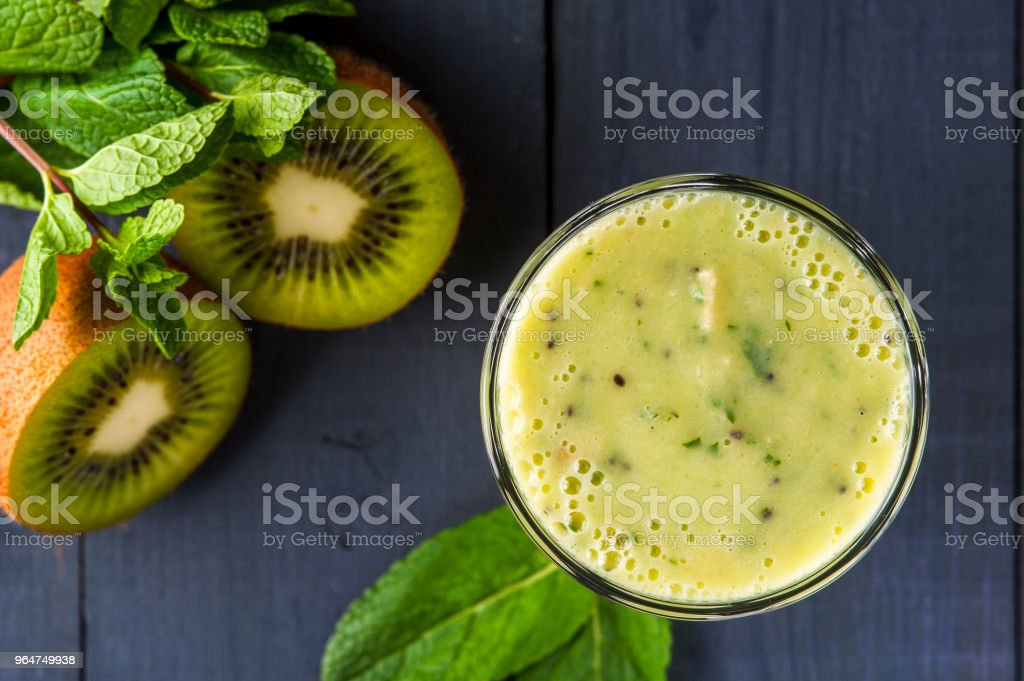 Glass of homemade smoothie with kiwi, banana and mint leaves . Conception of healthy food.  Nonalcoholic drinks. royalty-free stock photo