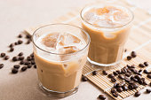 Glass of ice coffee with coffee bean