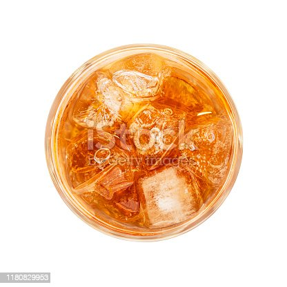 Close up one big high glass of iced tea cold drink isolated on white background, elevated top view, directly above