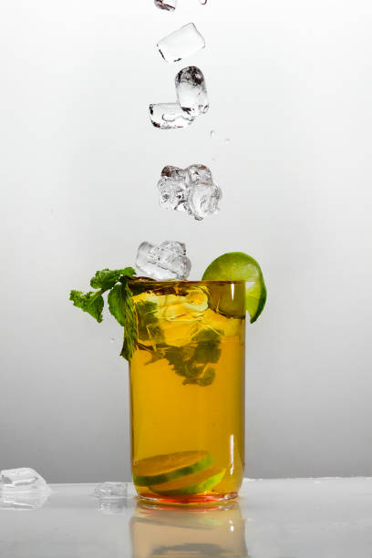 Glass of ice tea Ice lemon tea isolated on white background image stock pictures, royalty-free photos & images