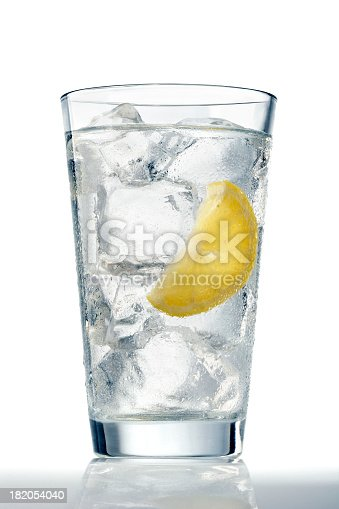 A glass of refreshing ice cold water with a lemon wedge.
