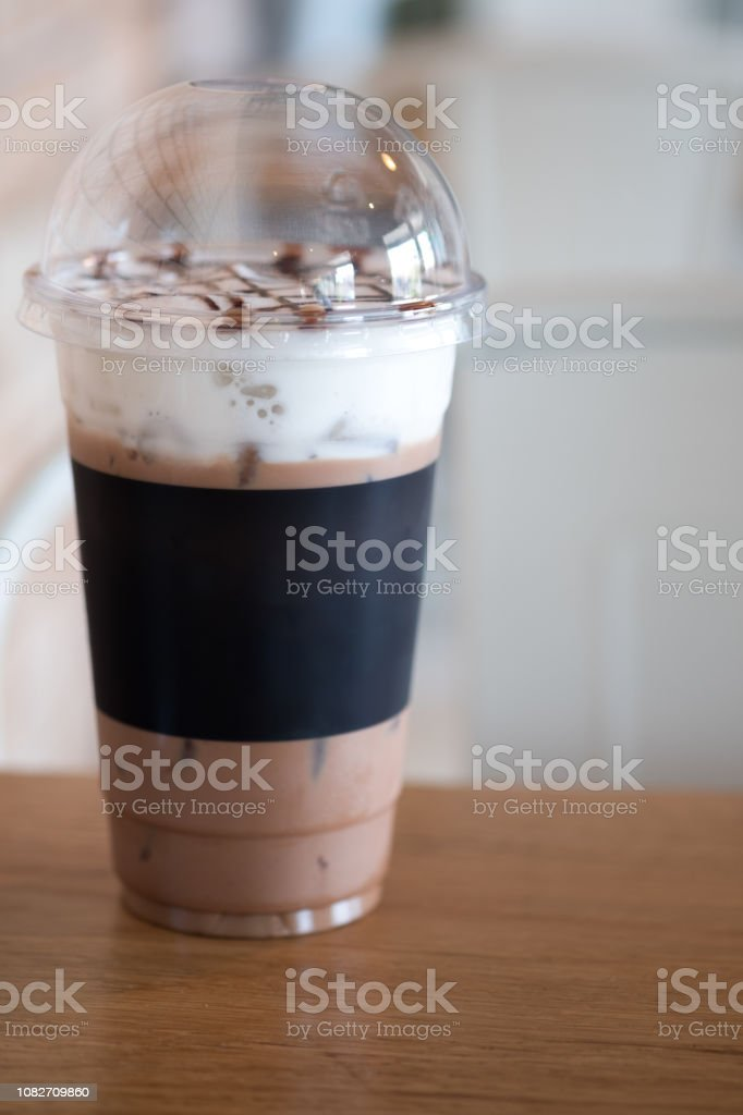 Glass of iced cocoa drink and milk froth cream foam stock photo