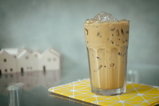 glass-of-iced-coffee-on-the-table-in-a-coffee-shop-picture-id1259001502?b=1&k=6&m=1259001502&s=170667a&w=0&h=xNAmhB3wUczZExrwgpxdTErIwrusxubVu6PMtEdbh_c=