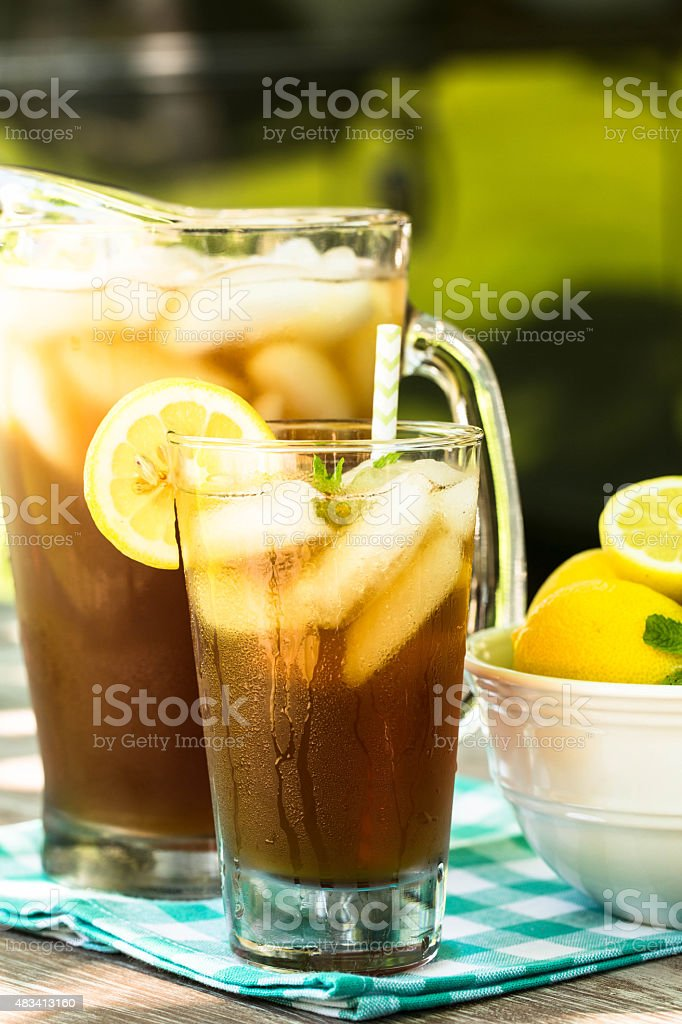 Glass of Iced Tea With Lemons and Mint In Summer stock photo