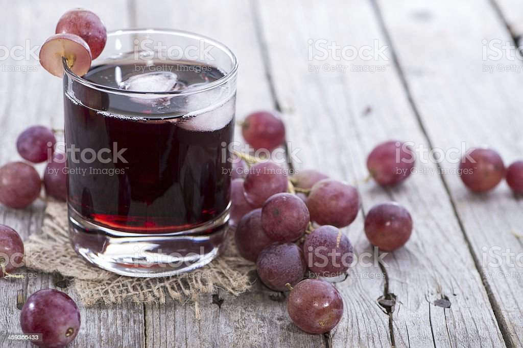 A glass of icy red grape juice stock photo