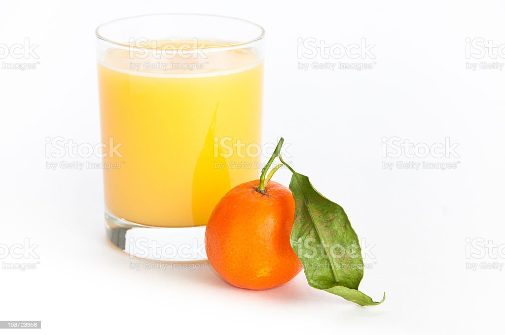Glass of  juice and an orange stock photo