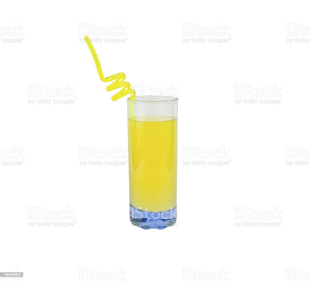 Glass of juice with straw royalty-free stock photo