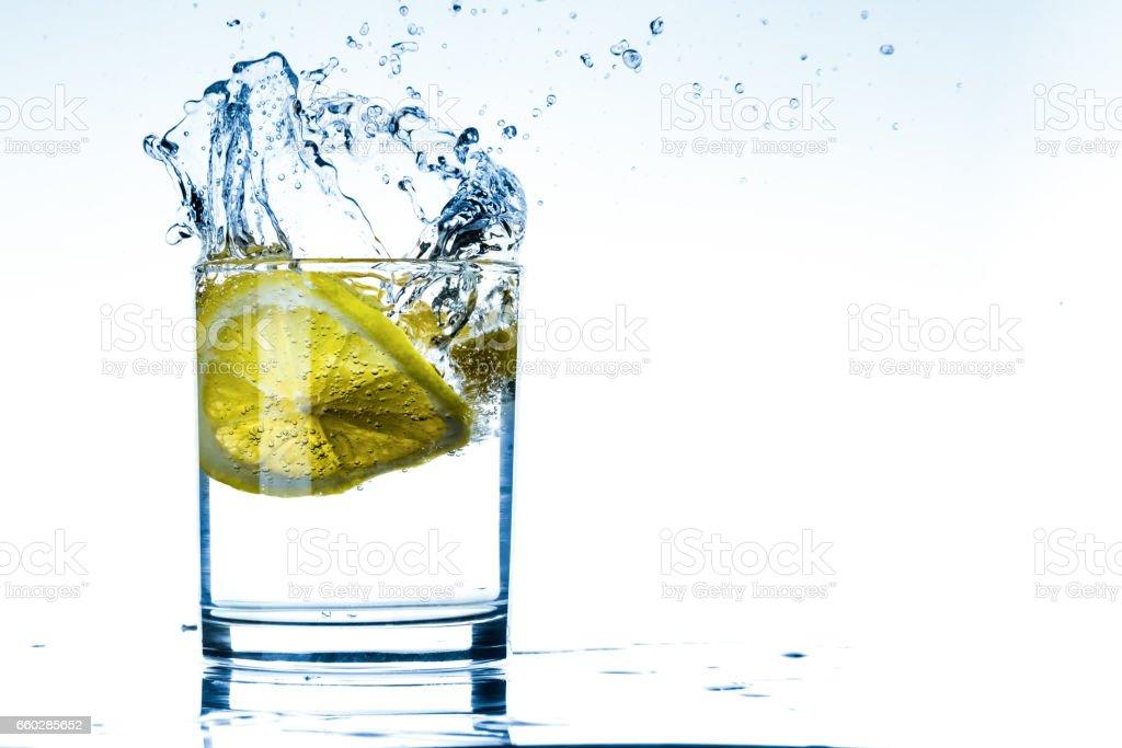 Glass of lemon water stock photo
