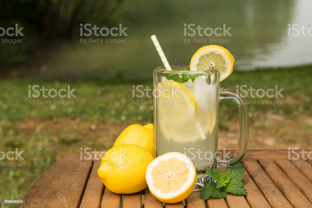 Glass of Lemonade By Lake stock photo