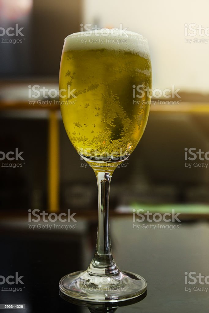 Glass of light beer in restaurant royalty-free stock photo