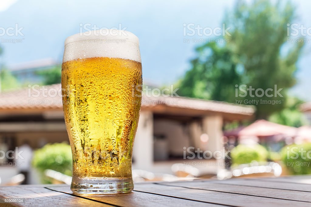 Glass of light beer on the table. stock photo