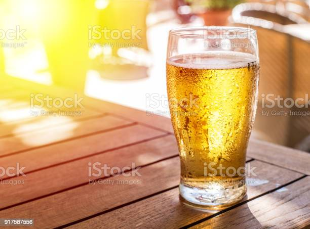Glass of light beer on the wooden table picture id917587556?b=1&k=6&m=917587556&s=612x612&h=10tajutez512 mn5ll4qt4xr 500onegourkvxhnaj8=