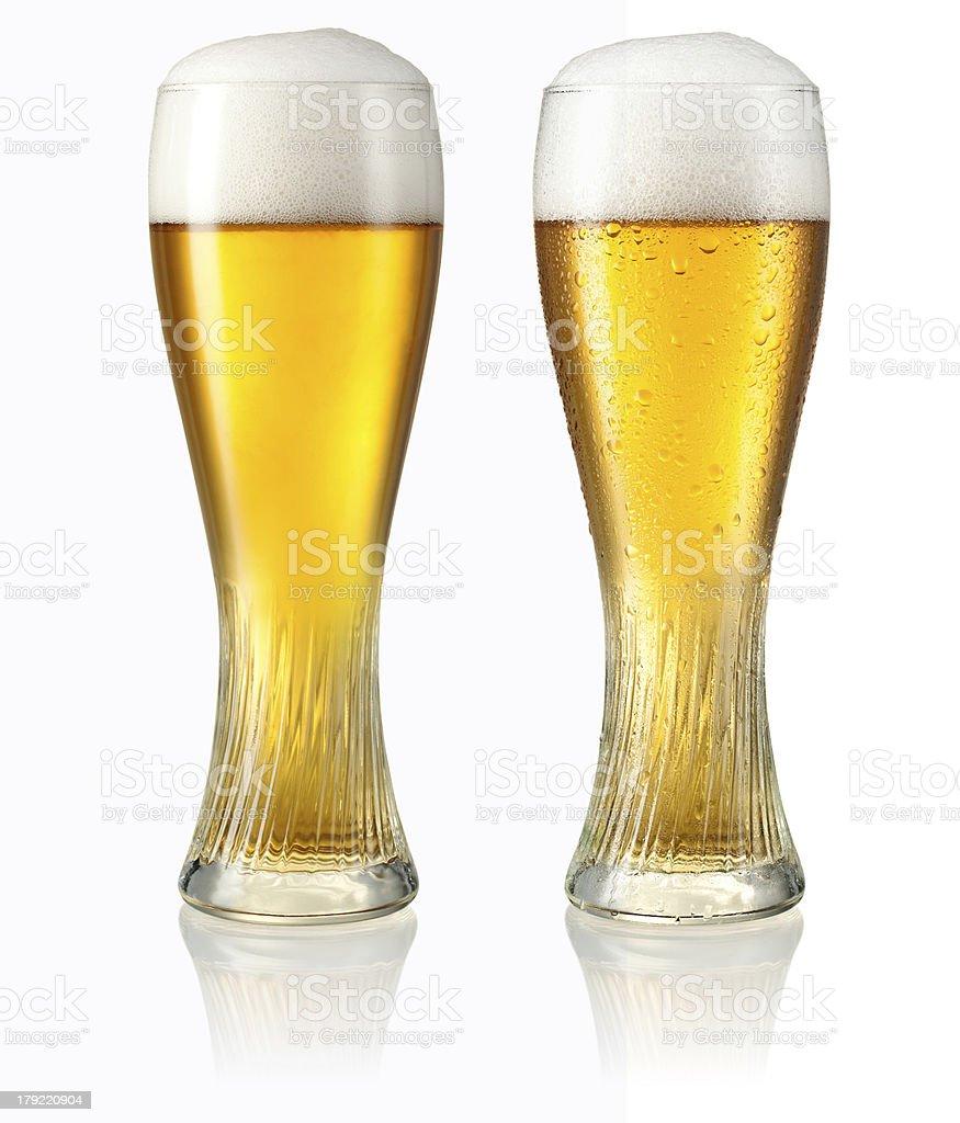 Glass of light beer on white stock photo