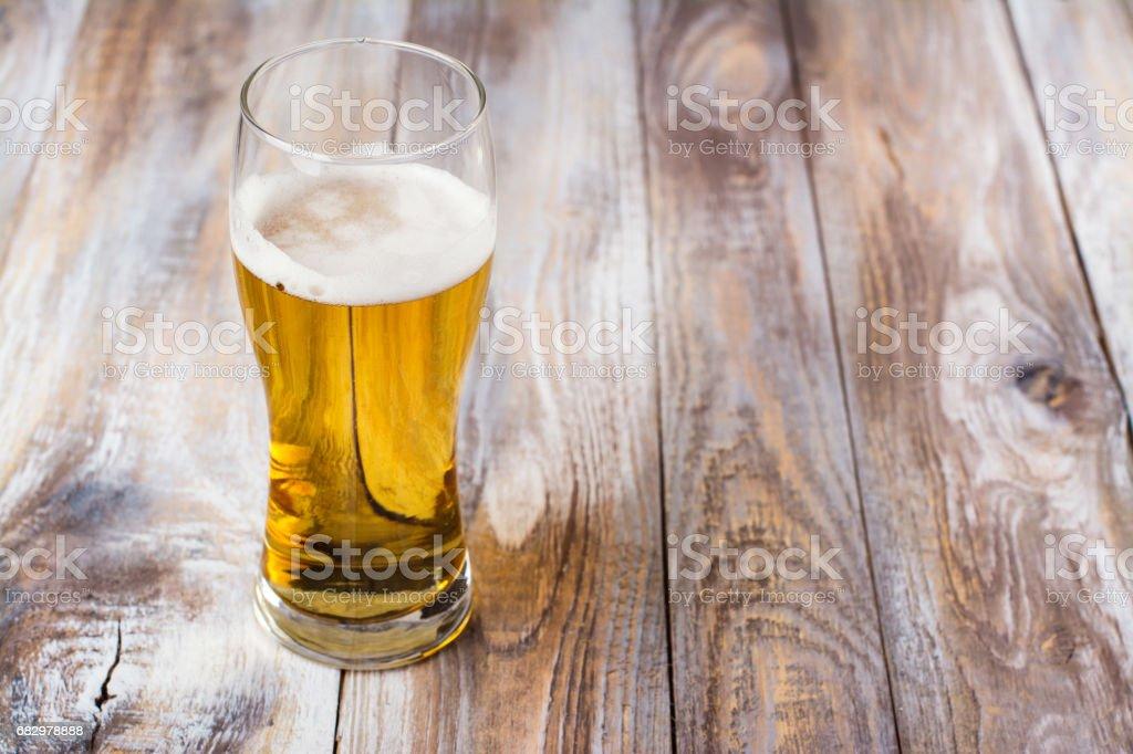 Glass of light beer on wooden background - foto de acervo