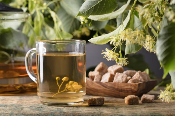 Glass of linden tea with brown sugar . stock photo