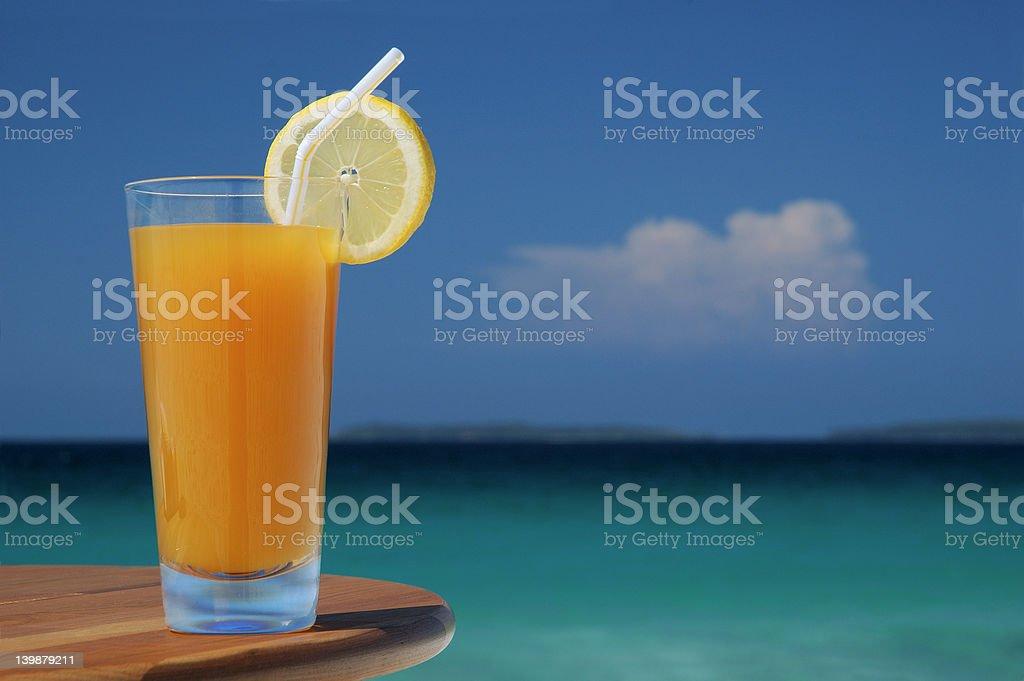 Glass of Mango Juice with Straw and Lemon Twist. royalty-free stock photo