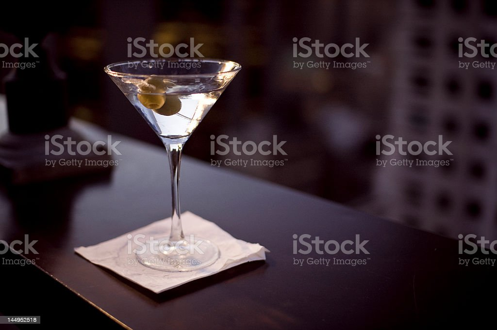 Glass of martini on a white napkin stock photo