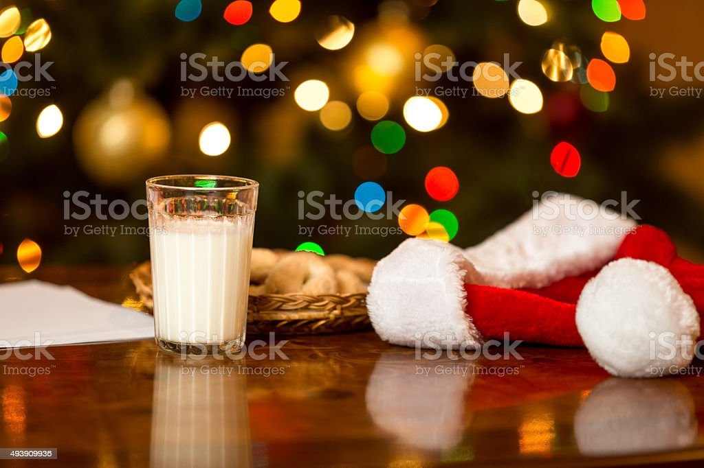 glass of milk and cookies for Santa on table stock photo