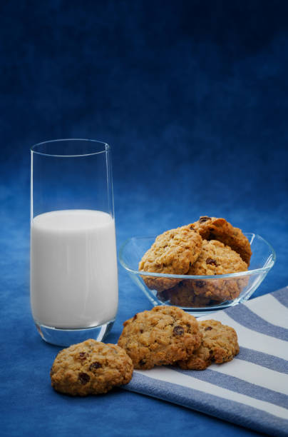 A glass of milk and homemade cookies stock photo