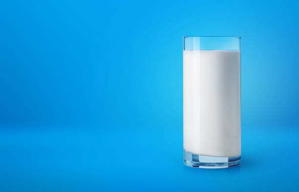 Glass of milk on blue background picture id884556966?b=1&k=6&m=884556966&s=612x612&w=0&h=egx3i96wopds5ipg jzql8x0bgw0ifqwklrx3pileh4=