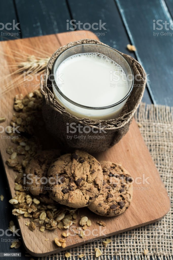 Glass of milk on table on blurred natural background royalty-free stock photo