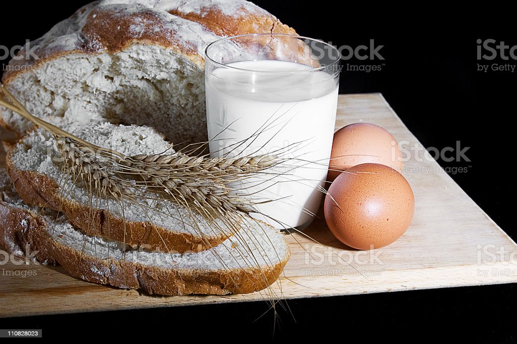 Glass of milk, wheat, eggs and bread royalty-free stock photo