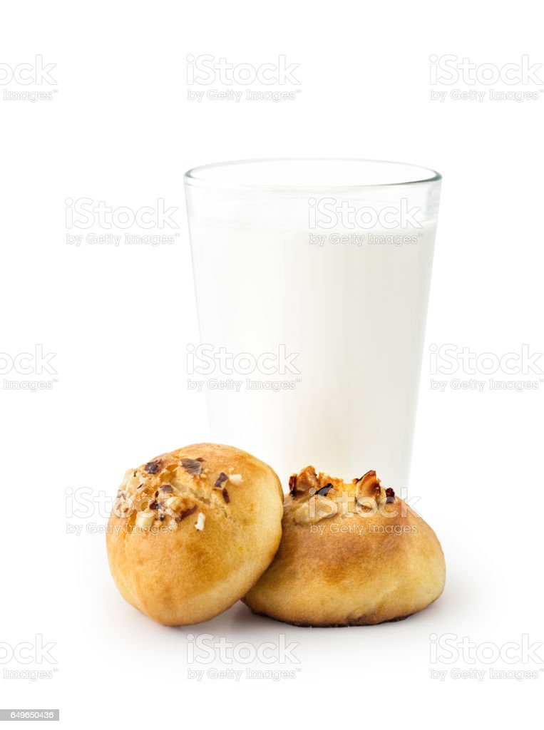 A glass of milk with cookies , isolated stock photo