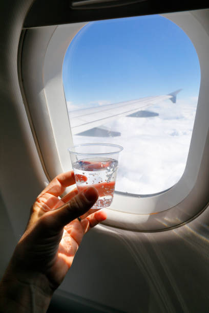 Glass of Mineral Water up in the Air. stock photo