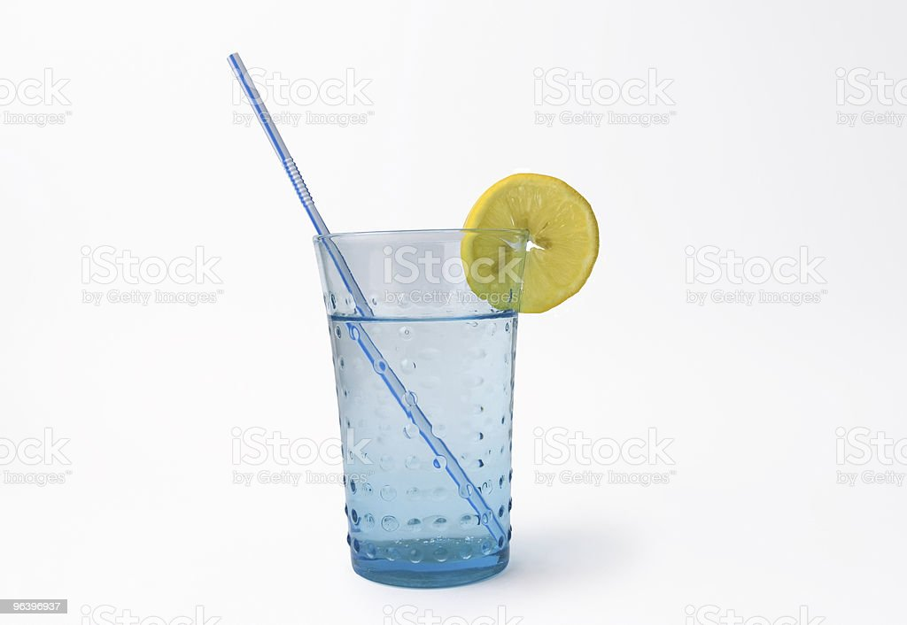 glass of mineral water with lemon and straw - Royalty-free Blue Stock Photo