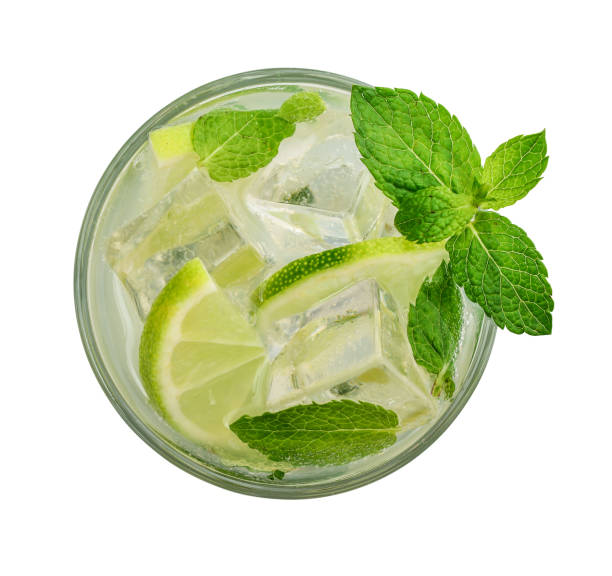 Glass of Mojito cocktail Glass of Mojito cocktail or soda drink with lime and mint isolated on white background, top view mojito stock pictures, royalty-free photos & images