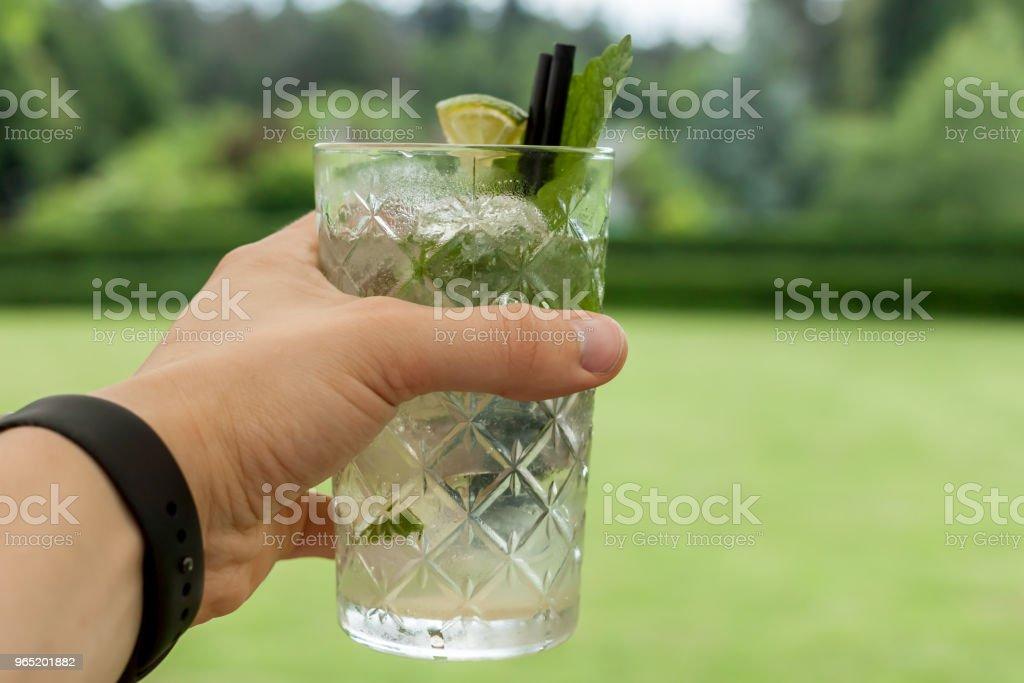 glass of mojito in female hand zbiór zdjęć royalty-free