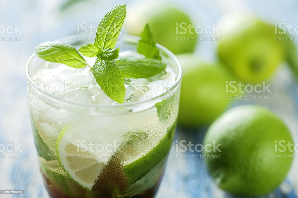 Glass of mojito with spearmint garnished on top stock photo