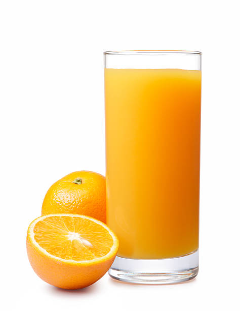 Glass of orange juice and fresh oranges stock photo