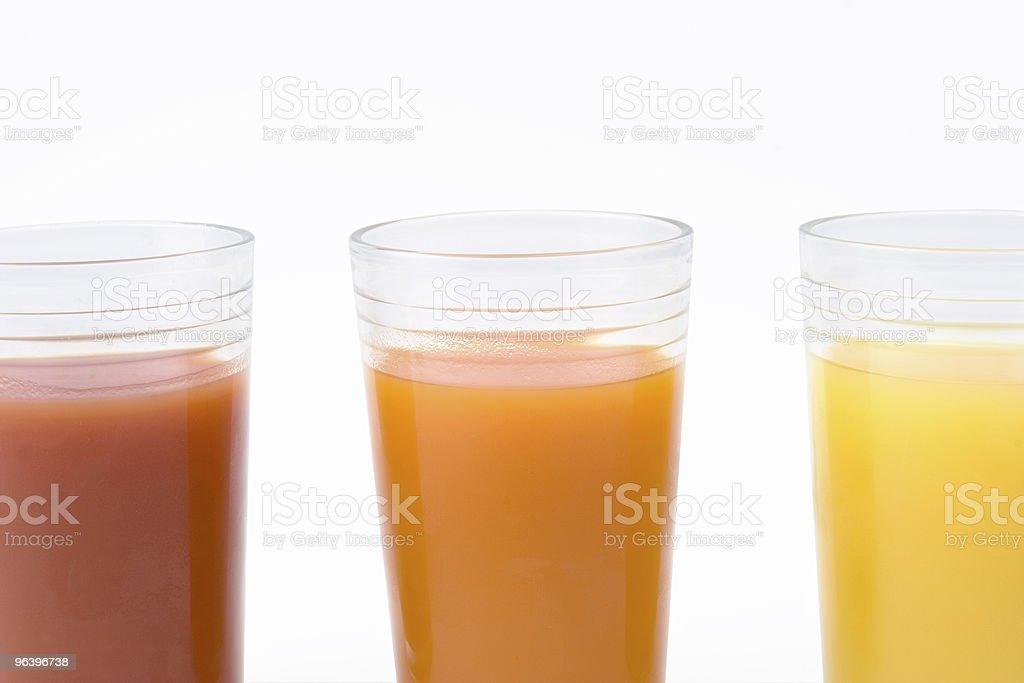 Glass of orange tomato and kiwi juice - close up - Royalty-free Backgrounds Stock Photo