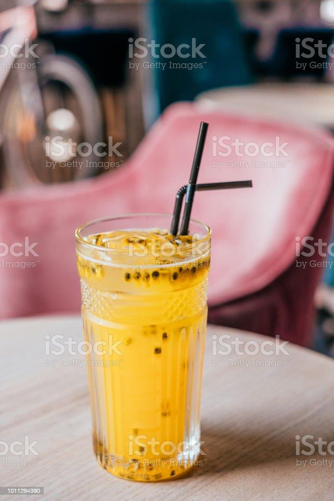 Glass of passionfruit lemonade stock photo