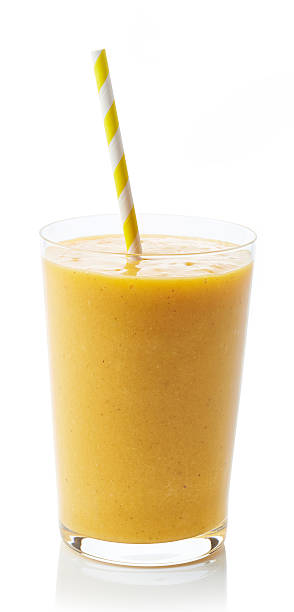 glass of peach smoothie - pfirsich milchshake stock-fotos und bilder