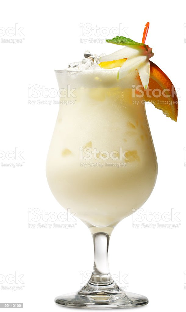 Glass of pi_a colada cocktail with fruit and straw stock photo