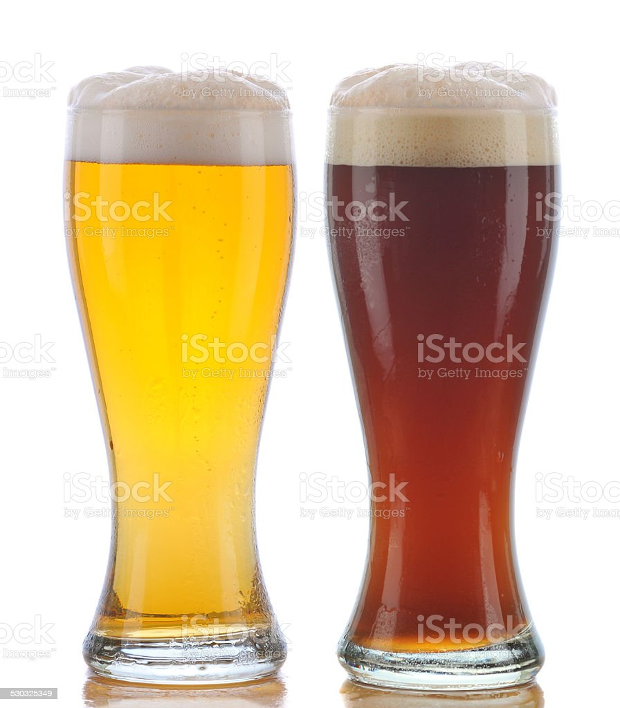 Glass of Pilsner and Dark Ale stock photo