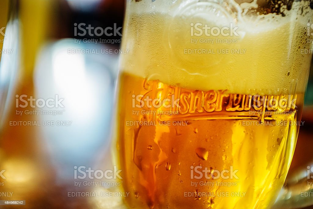 Glass of Pilsner Urquell Beer stock photo