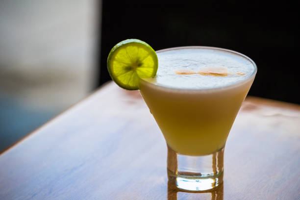 Lima, Peru - August 16, 2017: Glass of Pisco Sour in the city of Lima, Peru Lima, Peru - August 16, 2017: Glass of Pisco Sour in the city of Lima, Peru pisco peru stock pictures, royalty-free photos & images