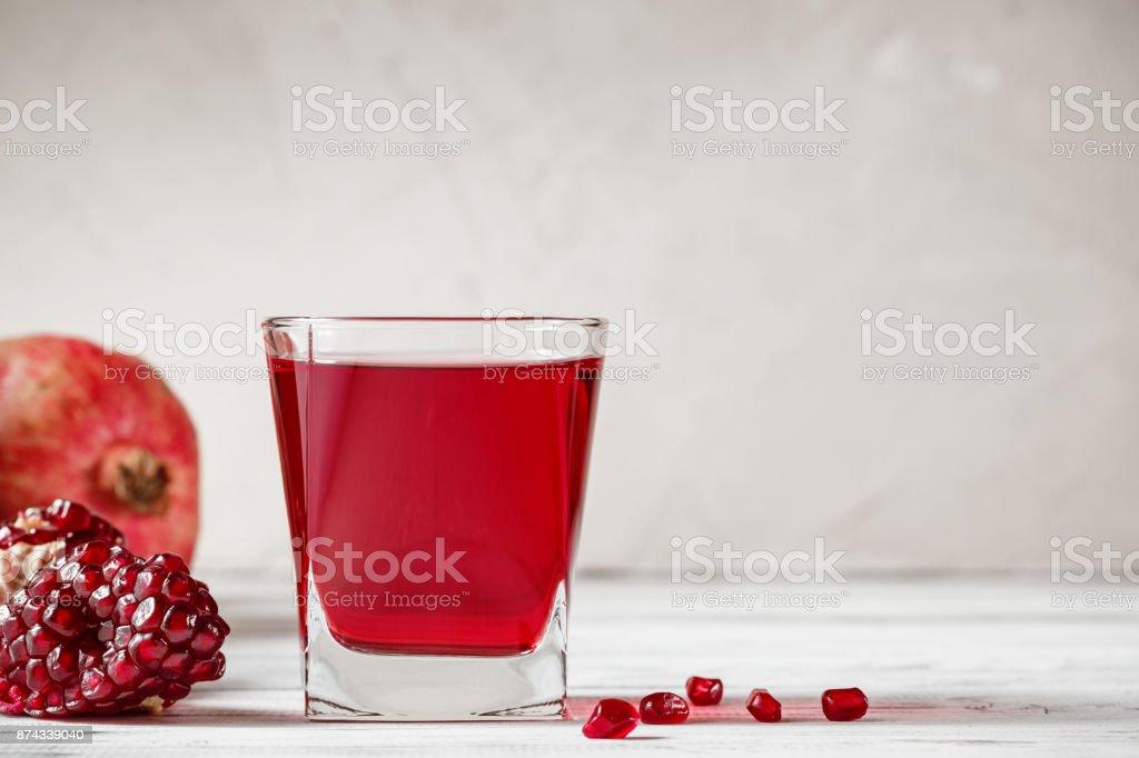 Glass of pomegranate juice with fresh pomegranate fruit stock photo