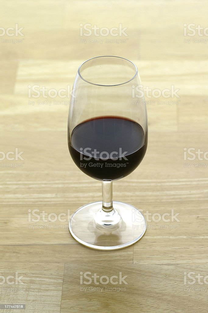 Glass of Port on Butcher Block surface stock photo