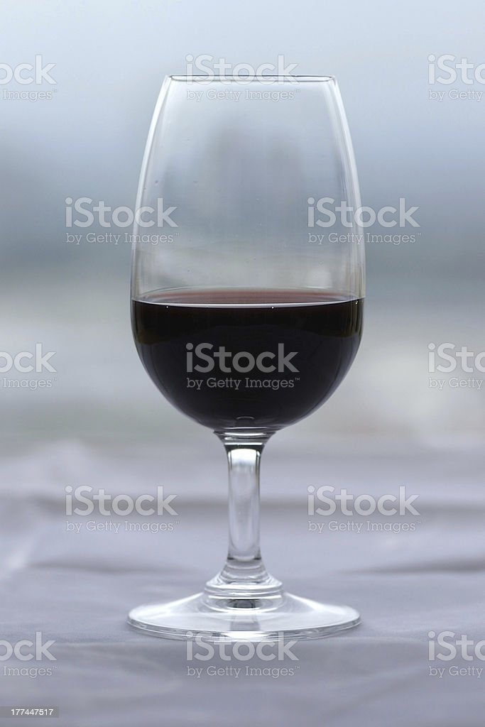Glass of Port wine against a muted green/grey background stock photo