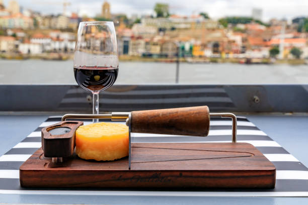 glass of port wine and cheese with the blurred cityscape of porto portugal in background - esplanada portugal imagens e fotografias de stock