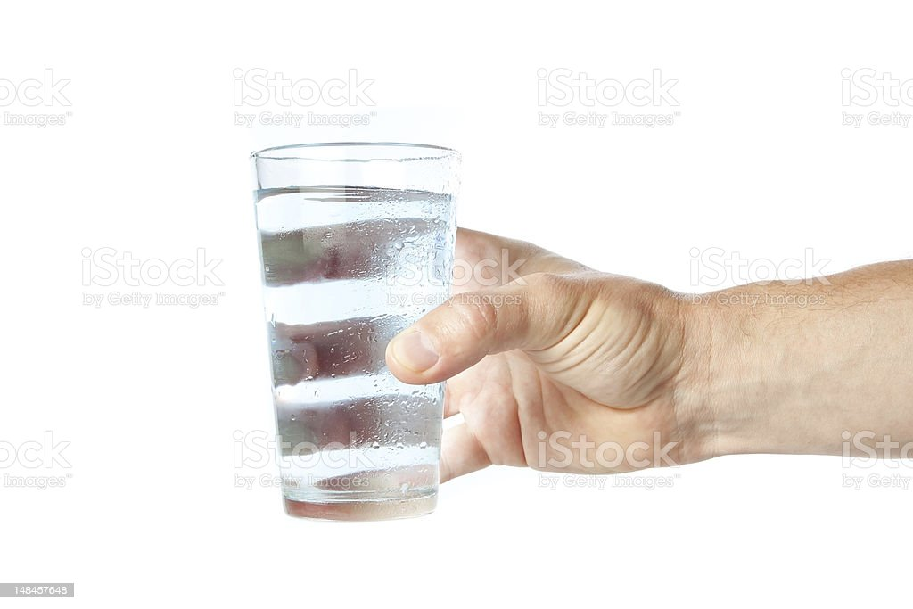 Glass of pure water in hand. stock photo